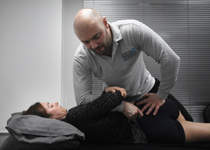 Scott performs an osteopathic manipulation on a patient